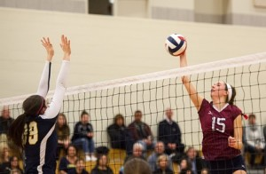 Westborough High School's Gianna Scioletti blasts this shot over the net as Arlington Catholic's Demiana Fogarty defends.