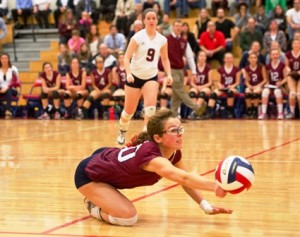 Westborough High School's Melissa Sullivan saves a point with this dig.