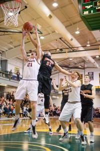 Marlborough High School's Joao Mendes beats Concord Carlisle Regional High School's David Poor to the rebound.