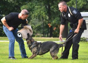 Presenting a demonstration are (l to r) Mike Baroni as a decoy with K-9 Zita and handler Officer Joe Coggans.