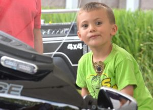 Dominic Georges, 4, sits on a Grafton Police motorcycle.