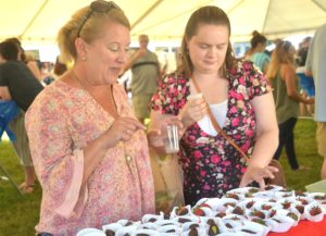 Marianne Thompson and Megan Cote choose treats from Edible Arrangements.
