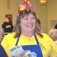 Rotarian Lynn Reynolds sells Turkey Trot raffle tickets. Photos/Ed Karvoski Jr.