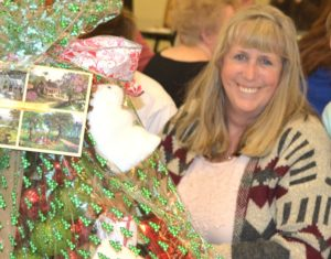 """Peggy Pomercy wins a """"Christmas Comfort"""" gift basket."""