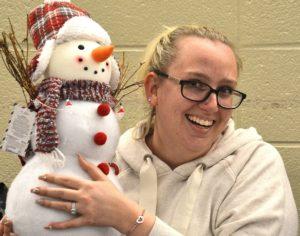Kelley Sorrentino wins a stuffed snowman.
