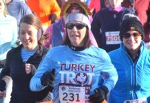 Festively attired with a turkey hat and tutu, Lauren Buerstatte begins the Westborough Turkey Trot 5K. Photos/Ed Karvoski Jr.