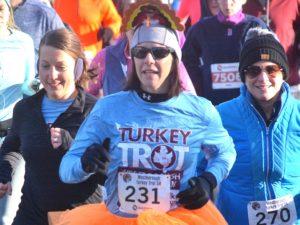Festively attired with a turkey hat and tutu, Lauren Buerstatte begins the Westborough Turkey Trot 5K. Photos/Ed Karvoski Jr.