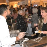 Marcio Barbosa of Checkerboards Restaurant and Bar in Hudson serves penne alla vodka to Ellen Mager. Photos/Ed Karvoski Jr.