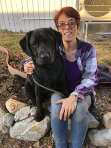 Rev. Lee's service dog, Shadow, is an integral partner in CoachRev @The CrossRoads helping people in need. Photo/courtesy of Rev Lee Atherton