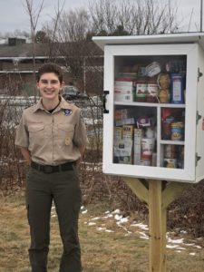 Eagle Scout Eleanor Stalcup stands next to her finished Eagle Scout project – the Little Free Pantry.