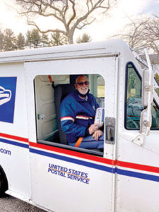 USPS mail carrier Bob Wendorf in his mail truck