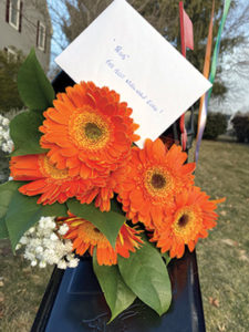 """A bouquet for Wendorf with the words """"For the best mailman ever."""""""