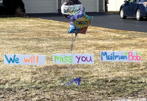 """Lawn signs with the words, """"We will miss you Mailman Bob"""" adorn a yard in the Northborough Northgate neighborhood."""