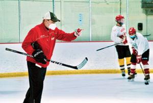 Hudson High School ice hockey coach Mike Nanartowich