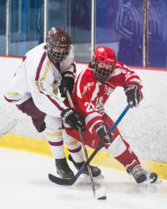 Algonquin's Nate Gallagher and Hudson's Ryan Carignan battle near the boards. Algonquin beat Hudson in this January 27 hockey game.