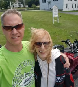 Marlborough Board of Health Director John Garside with his wife Susan and his favorite motorcycle