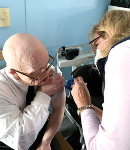 Jeffrey Fulham, a resident at a Thrive Support & Advocacy community home, receives his first COVID-19 vaccine shot at a clinic held in partnership with Marlborough's Bouvier Pharmacy on Jan. 6, 2021.