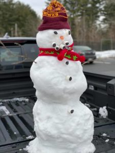 """Hausmann's new """"friend"""" (a snowman) with an Algonquin hat greeted him with a smile."""
