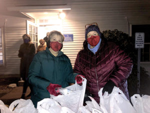 NJWC members Amy Walton and member Ruth Reeve packing meals for the Northborough Community Meals program.