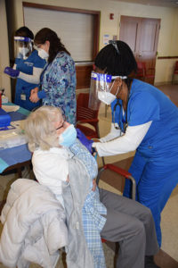 97-year-old Marlborough resident Regina Cahill is happy to get her vaccine from Francia Manneh, an LPN student at Assabet Valley Regional Technical School.