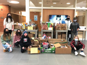 Quinn Middle School students assist the COVID Emergency Food Relief Program.