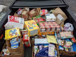A truckload of groceries was delivered to the COVID Emergency Food Relief Program thanks to the Quinn Middle School students.