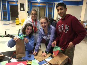 : Jillian Bolster, Cristel Alam, Sofia Bruno and Adish Jain of Westborough High School's Best Buddies program making crafts for Valentine's Day in February 2020