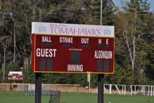 "A scoreboard bearing the now retired ""Tomahawk"" name towers over an Algonquin ballfield.  (Photo/Dakota Antelman)"