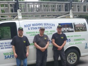 Brett, Bob and Chris Blanchette clean roofs and service gutters through their company, Roof Washing Services.
