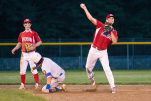 A Hudson Legion Post 100 player makes a hard throw from second base during his team's game against Ashland.