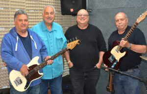 Larry Bee and the Buzz bandmates (l to r) Mike Ferro, retired chief dispatcher Larry Bastien, Tom Brodeur and retired EMT and firefighter Mickey Grasso; not pictured is Paul Rizzo  Photo/Ed Karvoski Jr.