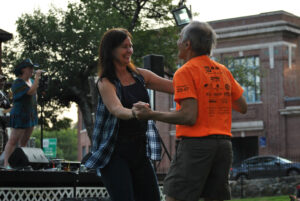 Kathy Lee dances with Paul Kusinitz. The two were part of a crowd of Southbound Train fans who followed their country music band to Marlborough, July 15.