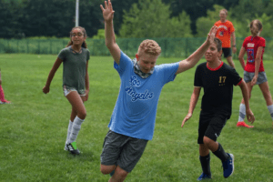 A youth soccer player celebrates during a recent day of activities through the Southborough Soccer Development Program.