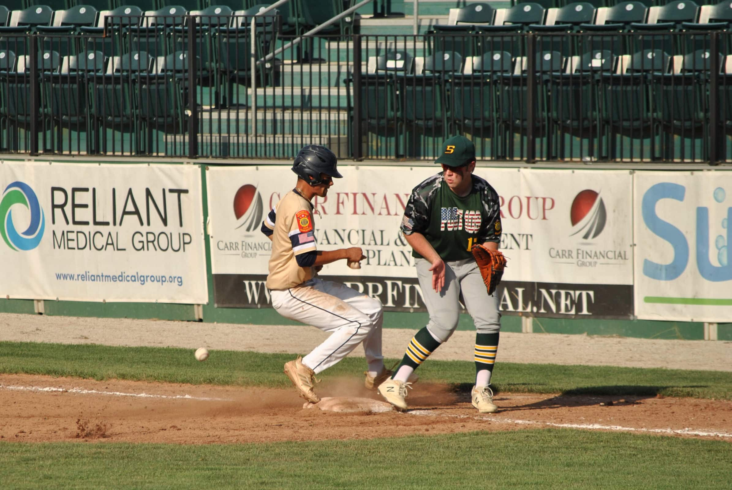 A Shrewsbury baserunner races back to first base after taking a long lead on a pop fly that was caught in the outfield.