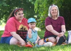 Zachary Baldelli, 2-1/2 (center), attends Outdoor Story Time with (l to r) his nanny Jen Sachetti and his grandmother Mary Baldelli.