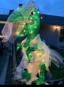 Rexy the dinosaur dons a wedding gown.