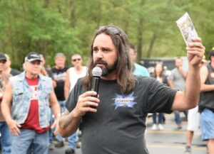 George Larassa holds a photo of his daughter Shawna while speaking to participants of the seventh annual Shawna Jean Larassa Memorial Ride in 2016 at the Marlborough Moose Family Center 1129.