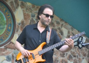The Midtown Horns' founder and bassist Greg Kojoyian performs July 15 at the Wood Park Music Shell in Hudson.
