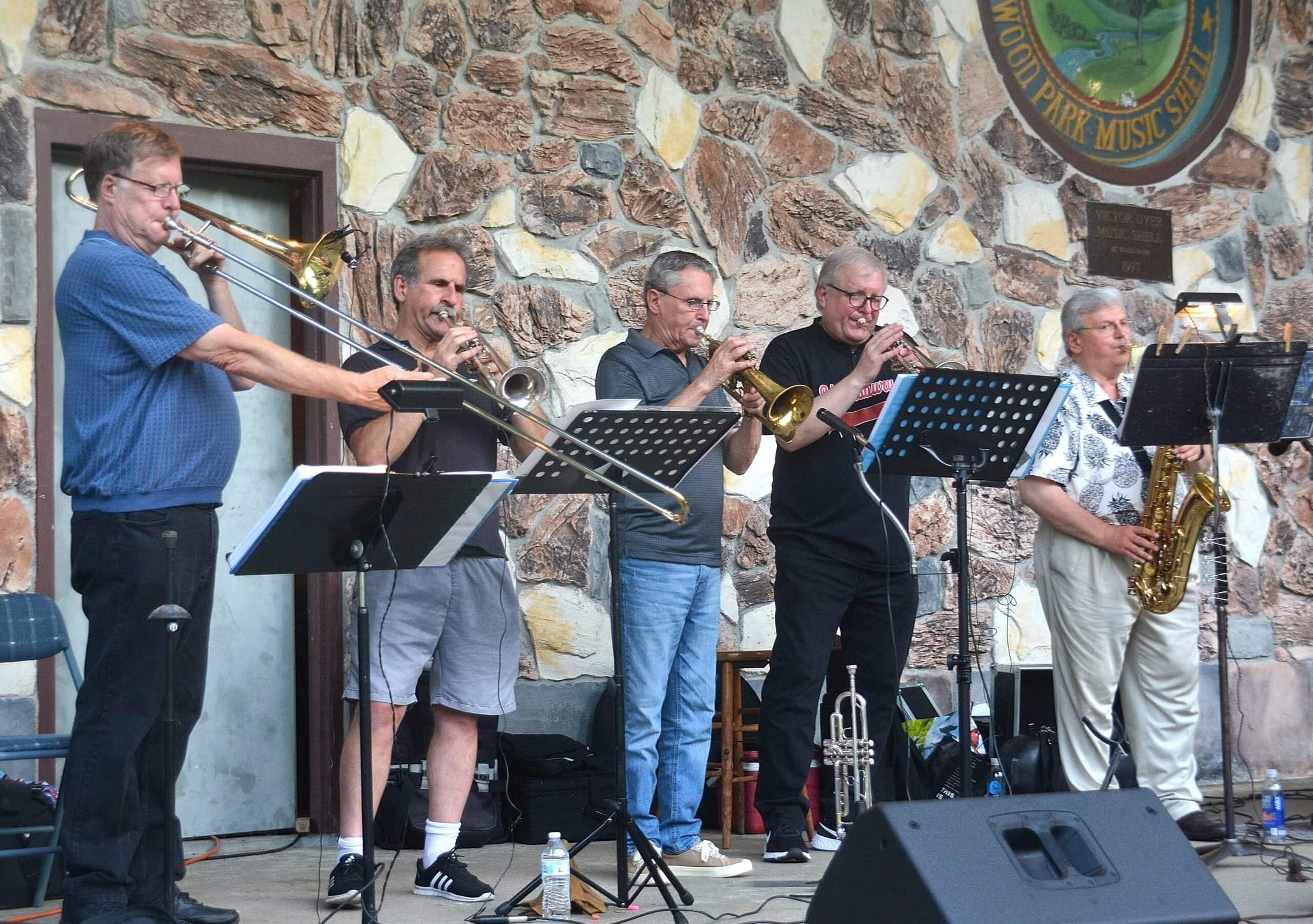 Greg Kojoyian (far left) plays bass alongside vocalists at Hudson's Wood Park Music Shell during The Midtown Horns concert. (Photo/Ed Karvoski Jr.)