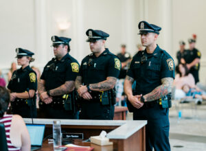 Officers Elysha O'Brien, William Ethier Jr., Peter Gerardi Jr. and Thomas Tepper stand together during the Westborough Police Department's July 20 promotion ceremony.