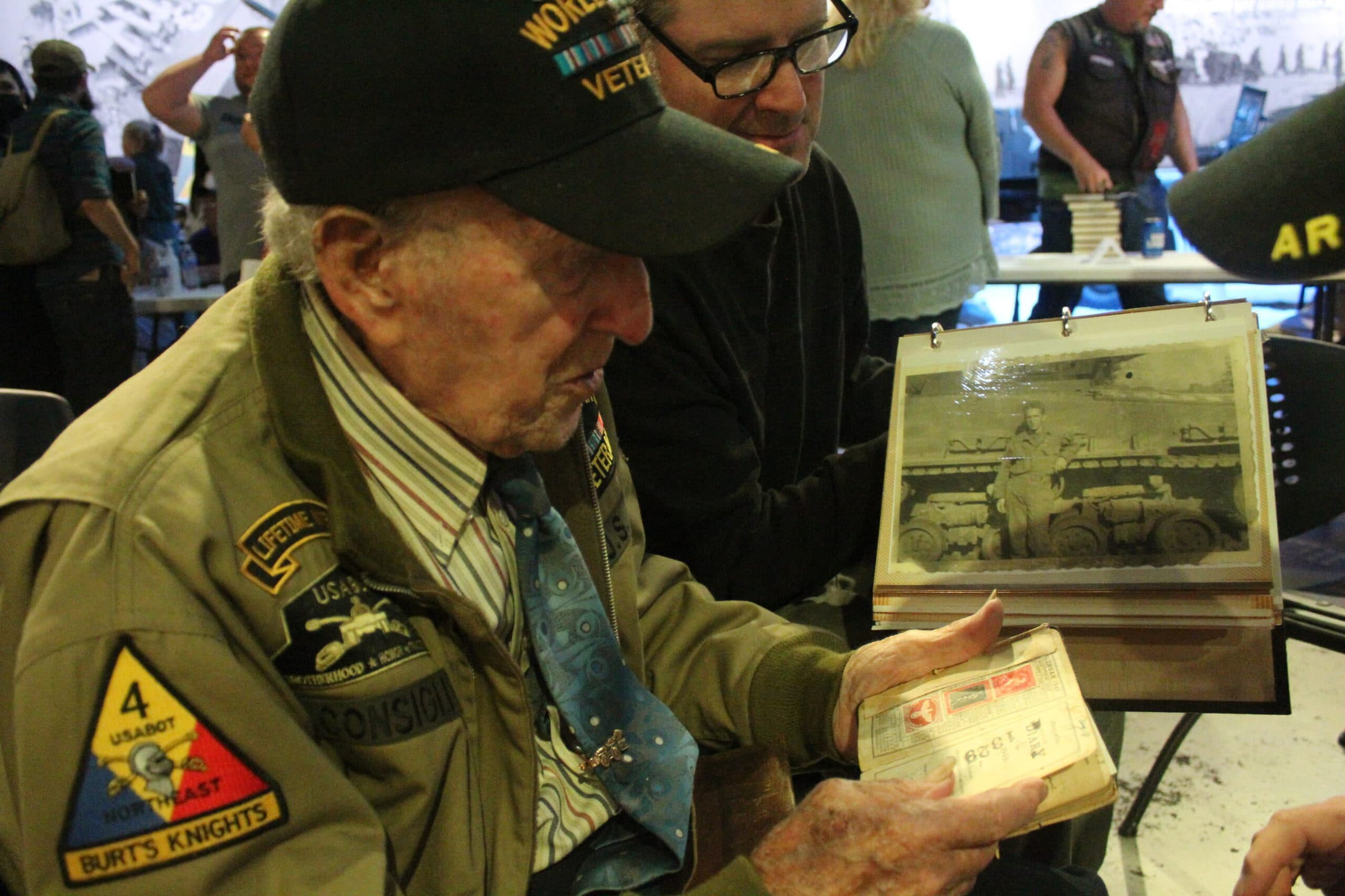 Albert Consigli shows the journal he kept during WWII.