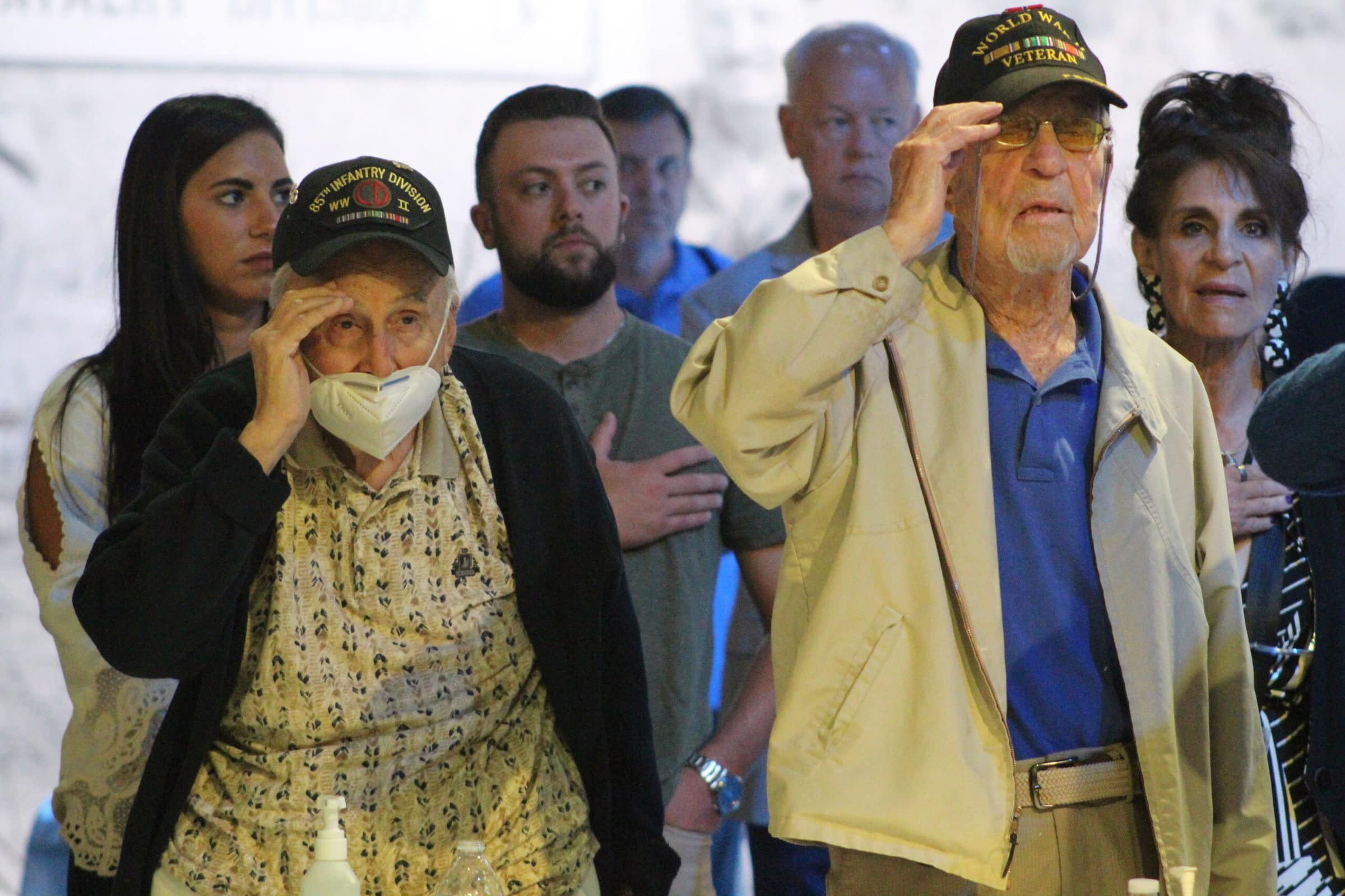 Veterans salute during the National Anthem.