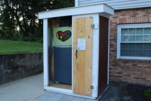 The 'Friend Fridge' sits at the Northborough Food Pantry at 37 Pierce Street. Seeking to fight food insecurity, Friend Fridge supporters quickly found their actual refrigerator did not work. Now they're thanking community members for helping them buy a new fridge.  Photo/Laura Hayes