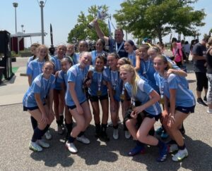 The FC Stars ECNL White team celebrates after winning a National Cup XX U14 Super Group championship.