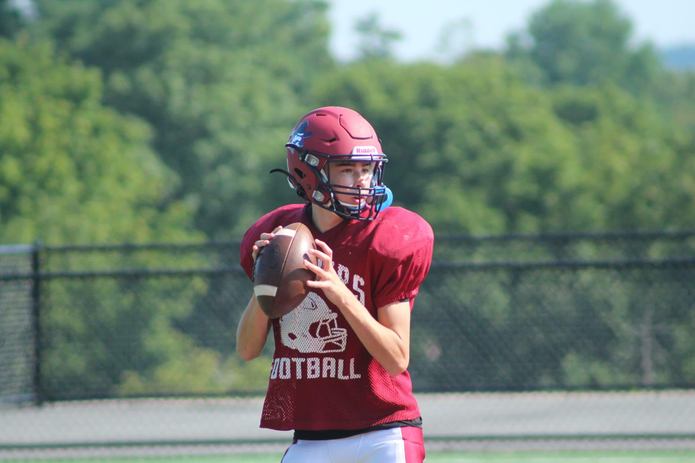 A Westborough quarterback prepares to throw the ball.
