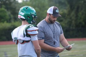 A Grafton coach talks with a player during a recent practice.