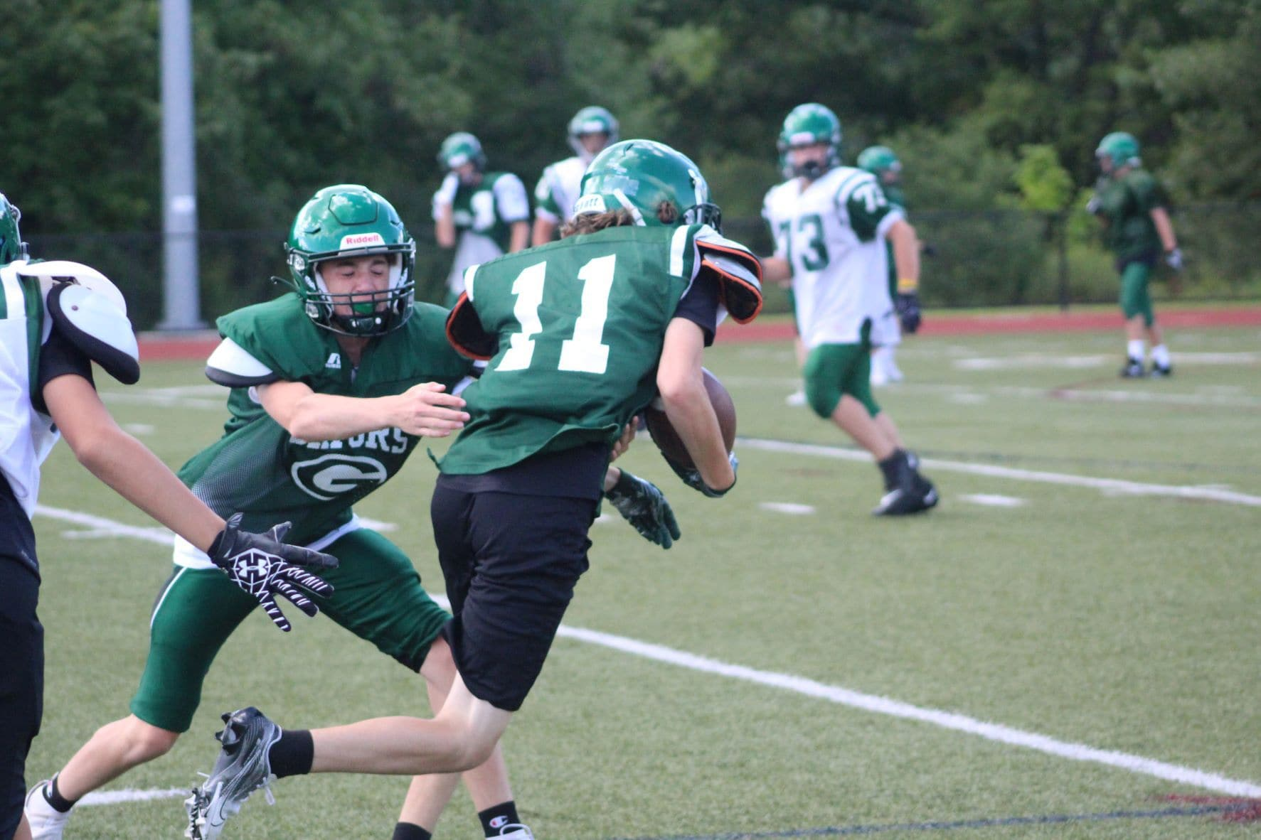 A Grafton player lunges for a tackle.
