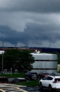 Apparent funnel clouds descend from larger stormclouds over Westborough. Photo/courtesy John Bogaert