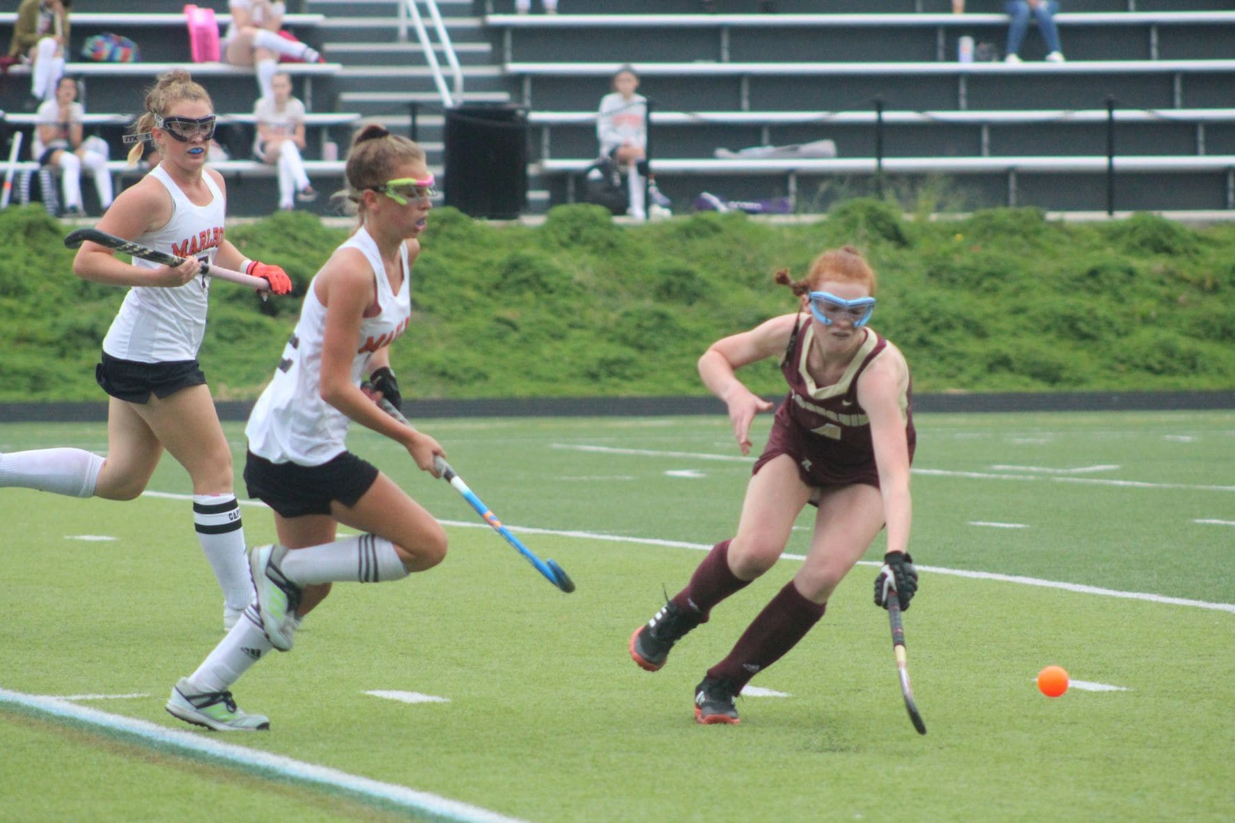 An Algonquin player lunges to gain possession of a loose ball during a recent game.