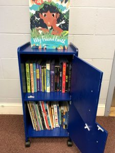 A small book rack is ready for children to select books.